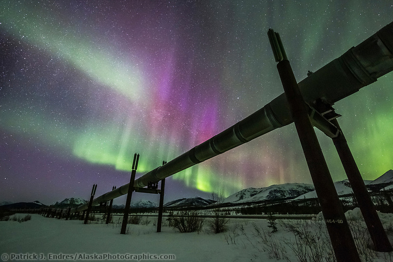 Northern Lights and the Alaska oil pipeline, Brooks Range in the distance.
