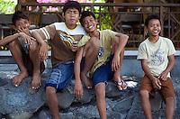 September 8th 2007- Bali, Indonesia- Local kids work as porters, caring diving tanks for dive tourists in an area known as Jemeluk Bay, which is located near the Amed area of North East Bali. The area around Amed is very dry and not suitable for rice, so the local population depends heavily on the tourism trade. The dive shops pay monthly dues to the villages and pay to use local porters to carry tanks and boats to reach the sites. Photograph by Daniel J. Groshong/Tayo Photo Group