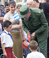Cuban leader Fidel Castro, (R), speaks with Elian Gonzalez, at the closing ceremony of a meeting of the island's communist group for schoolchildren in Havana, Cuba Tuesday, July 10, 2001.. Credit: Jorge Rey/MediaPunch