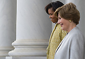 Washington, DC - January 20, 2009 -- First lady Michelle Obama walks alongside Laura Bush to a waiting helicopter for former US President George W. Bush,after Barack Obama was sworn in as the 44th US president at the US Capitol in Washington, DC, on January 20, 2009. .Credit: Saul Loeb - Pool via CNP