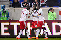 Peguy Luyindula (8) of the New York Red Bulls celebrates scoring with teammates Bradley Wright-Phillips (99) and Lloyd Sam (10). The New York Red Bulls and Chivas USA played to a 1-1 tie during a Major League Soccer (MLS) match at Red Bull Arena in Harrison, NJ, on March 30, 2014.