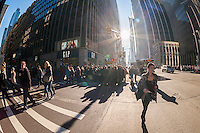 Crowds of tourists on Sixth Avenue in New York on the weekend after Christmas, Saturday, December 27, 2014. A sunny warm winter's day brought out thousands to shop and sight see, congesting the sidewalks. (© Richard B. Levine)