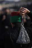 KARBALA, IRAQ: A Shia pilgrim flagellates himself in mourning...Shia pilgrims pray during the last day of the Ashura festival...Photo by Metrography