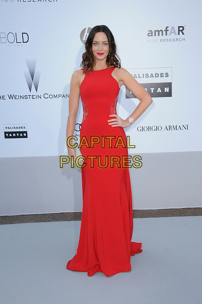 EMILY BLUNT.arrivals at amfAR's Cinema Against AIDS 2010 benefit gala at the Hotel du Cap, Antibes, Cannes, France during the Cannes Film Festival.20th May 2010.amfAR full length red long maxi dress  hand on hip sleeveless silver clutch bag .CAP/CAS.©Bob Cass/Capital Pictures.