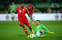 FUSSBALL   1. BUNDESLIGA   SAISON 2012/2013    22. SPIELTAG VfL Wolfsburg - FC Bayern Muenchen                       15.02.2013 David Alaba (li, FC Bayern Muenchen) gegen Vierinha (re, VfL Wolfsburg)