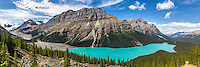Peyto Lake and Mount Caldron towering above. Mount Patterson is too the right of Mount Caldron. The steady supply of glacial flour from the melting glaciers above create the crazy cyan color of Peyto Lake. <br />