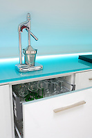 The kitchen contains specially designed drawers for the storage of glassware