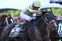HOT SPRINGS, AR - April 15: Classic Empire #2 and jockey Julien Leparoux run down Conquest Mo Money to win the Arkansas Derby at Oaklawn Park on April 15, 2017 in Hot Springs, AR. (Photo by Ciara Bowen/Eclipse Sportswire/Getty Images)