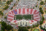 Aerial view of War Memorial Stadium in Little Rock, Arkansas during a Razorback football game.  Fans dressed in red, white, and blue to create the American Flag in memory of the September 11th tragedies.
