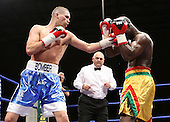 Tony Bellew (Liverpool, blue shorts) defeats Ayittey Powers (St Pancras, yellow shorts) in a Light-Heavyweight contest at Goresbrook Leisure Centre, Dagenham, Essex promoted by Frank Maloney / FTM Sports - 18/07/08 - MANDATORY CREDIT: Gavin Ellis/TGSPHOTO - Self billing applies where appropriate - Tel: 0845 094 6026.