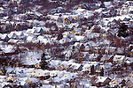 Snow cover blankets the town of LaCrosse, WI on a cold winter day, as seen from Grandad Bluff Park.