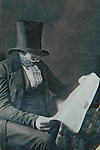 Conceptual image of male wearing victorian clothes reading newspaper