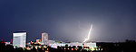 This bolt of lightning lit up the complete downtown area with it's intense flash. as a thunderstorm with bright lightning moved quickly over the city tonight washing out roads, downing power lines and sending trees through roofs of homes.