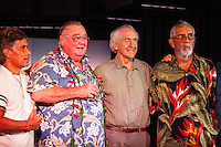 """HONOLULU, Turtle Bay Resort, North Shore, Oahu. - (Thursday, January 3, 2013) Reno Abellira (HAW), Greg Noll (USA) Peter Cole (USA) and  Kimo Hollinger (HAW).  Greg Noll (USA) was the guest  speaker of Talk Story at Surfer The Bar tonight. Noll, nicknamed """"Da Bull"""" by Phil Edwards in reference to his physique and way of """"charging"""" down the face of a wave is an American pioneer of big wave surfing and is also acknowledged as a prominent longboard shaper. Noll was a member of a US lifeguard team that introduced Malibu boards to Australia around the time of the Melbourne Olympic Games. Noll became known for his exploits in large Hawaiian surf on the North Shore of Oahu. He first gained a reputation in November 1957 after surfing Waimea Bay in 25-30 ft surf when it had previously been thought impossible even to the local Hawaiians. He is perhaps best known for being the first surfer to ride a wave breaking on the outside reef at the so-called Banzai Pipeline in November 1964...It was later at Makaha, in December 1969, that he rode what many at the time believed to be the largest wave ever surfed. After that wave and the ensuing wipeout during the course of that spectacular ride down the face of a massive dark wall of water, his surfing tapered off and he closed his Hermosa Beach shop in the early 1970s. He and other surfers such as Pat Curren, Mike Stang, Buzzy Trent, George Downing, Mickey Munoz, Wally Froyseth, Fred Van Dyke and Peter Cole are viewed as the most daring surfers of their generation...Noll is readily identified in film footage while surfing by his now iconic black and white horizontally striped """"jailhouse"""" boardshorts and was interviewed by host Jodi Wilmott (AUS). . Photo: joliphotos.com"""