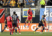 CHESTER, PA - AUGUST 12, 2012:  Brian Carroll (7) and Josué Martínez (17) of the Philadelphia Union watch  Michael Videira (21) of the Chicago Fire head the ball clear during an MLS match at PPL Park, in Chester, PA on August 12. Fire won 3-1.