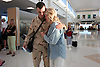 "Bound back for Iraq Brent Leet, 22, a United States Army specialist, comforts his mother, Penny Leet, as they say goodbye for a second time at Southwest Florida International's new Midfield Terminal in Ft. Myers Friday. Leet was on leave for two weeks visiting his family in Port Charlotte from Iraq. The short vacation split up his second tour of duty in to two six month stints. ""I'm terrified he might not come home."" said Penny Leet. ""I am thrilled and honored my son is one of those heros to bring democracy to that part of the world."" Erik kellar/Staff"