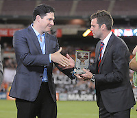 D.C. United Managing Partner Jason Levin gives D.C. United Head Coach Ben Olsen a plaque on his induction in the D.C. United Hall of Fame. D.C. United defeated The New England Revolution 2-1 at RFK Stadium, Saturday September 15, 2012.