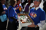 A member of the First Unitarian Church hands out cupcakes at San Francisco's City Hall to support and celebrate same-sex marriages, in San Francisco, CA, on Tuesday, June 17, 2008.