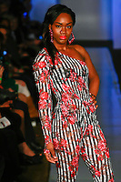 Model walks runway in an outfit from the Swarey Designs Fall 2012 collection by Dareyna Swann, at Plitzs Fashion Week New York, during New York Fashion Week Fall 2012.