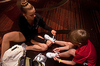 New York, NY - July 05, 2013 : Lucy Spring, 18 helps her little brother Luke Spring, 10, with his shoes after class at the New York City Dance Alliance National Summer Workshop held at the Sheraton New York Times Square Hotel in New York, NY on  July 05, 2013. Luke Spring, a dance prodigy from Studio Bleu Dance Center in Ashburn, VA, has performed on the Tonys, Ellen, So You Think You Can Dance and The Ford Gala. His sisters Cami Spring, 20, and Lucy Spring, 18, are both award winning dancers. (Photo by Melanie Burford/Prime for The Washington Post)