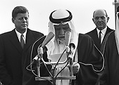 King Saud of Saudi Arabia, center, makes remarks at Andrews Air Force Base outside Washington, DC on February 13, 1962 after being welcomed by United States President John F. Kennedy, left.  U.S. Secretary of State Dean Rusk looks on at right..Credit: Arnie Sachs / CNP