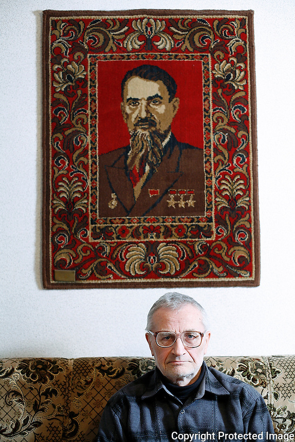 When Valentin Kupny retired as supervisor of the Chernobyl Sarcophagus, he was given a carpet decorated with the portrait of physicist Igor Kurchatov, founder of the Soviet atomic program.  <br /> ------------------- <br /> This photograph is part of Michael Forster Rothbart's After Chernobyl documentary photography project.<br /> &copy; Michael Forster Rothbart 2007-2010.<br /> www.afterchernobyl.com<br /> www.mfrphoto.com <br /> 607-267-4893 o 607-432-5984<br /> 5 Draper St, Oneonta, NY 13820<br /> 86 Three Mile Pond Rd, Vassalboro, ME 04989<br /> info@mfrphoto.com<br /> Photo by: Michael Forster Rothbart<br /> Date:   1/2009    File#:  Canon 5D digital camera frame 51922<br /> ------------------- <br /> Original caption: .None