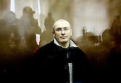 Former Yukos oil giant CEO Mikhail Khodorkovsky at a court room in Moscow, Russia, Tuesday, March 31, 2009. The trial begins Tuesday for former oil tycoon Mikhail Khodorkovsky and business partner Platon Lebedev..Khodorkovsky's supporters claim this trial is just a new phase of a reprisal campaign driven by political calculations, commercial interests and personal motives. A new conviction and sentence would send a signal that nothing has changed despite President Medvedev's words, they say, while an acquittal would mark a break with the Putin era.