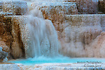 A photo of a cascading waterfall and themal pool in Mammoth Hot Springs.