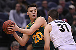 MILWAUKEE, WI - MARCH 16:  Vermont Catamounts guard Ernie Duncan (20) looks for an open teammate during the first half of the 2017 NCAA Men's Basketball Tournament held at BMO Harris Bradley Center on March 16, 2017 in Milwaukee, Wisconsin. (Photo by Jamie Schwaberow/NCAA Photos via Getty Images)
