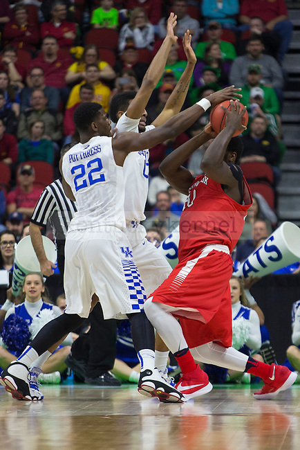 Forward Alex Poythress and Forward Marcus Lee of the Kentucky Wildcats play tight defense during the NCAA Tournament first round game against the Stony Brook Seawolves at Wells Fargo Arena on Thursday, March 17, 2016 in Des Moines, Iowa. Photo by Michael Reaves   Staff.