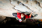 "Jeff Jackson on the first ascent of his route ""The Pink Wall"" 5.12b/c.  Redstone, CO."