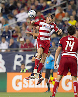 New England Revolution midfielder Chris Tierney (8) and FC Dallas defender Andrew Jacobson (4) battle for head ball. In a Major League Soccer (MLS) match, the New England Revolution defeated FC Dallas, 2-0, at Gillette Stadium on September 10, 2011.