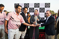 Her Highness Rajmata Padmini Devi (center) and Jewelry designer Nirav Modi (right) present the winner's trophy to the Royal Jaipur Polo Team after they beat the Western Australian Polo Team by a slight margin at thelast minutes of the Argyle Pink Diamond Cup, organised as part of the 2013 Oz Fest in the Rajasthan Polo Club grounds in Jaipur, Rajasthan, India on 10th January 2013. Photo by Suzanne Lee