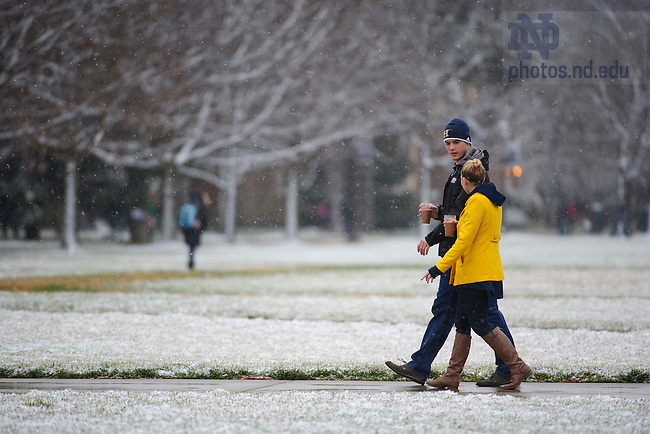 Dec. 10, 2012; Students walk across South Quad during a snow shower. Photo by Barbara Johnston/University of Notre Dame
