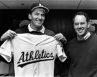 Oakland Athletics sign right handed pitcher Mike Moore. General Manager Sandy Alderson. (1989 photo  by Ron Riesterer)