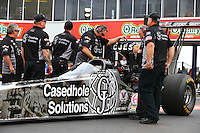 Apr 24, 2015; Baytown, TX, USA; Crew members prepare to start the engine for NHRA  top fuel driver Larry Dixon during qualifying for the Spring Nationals at Royal Purple Raceway. Mandatory Credit: Mark J. Rebilas-