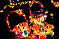 Colorful basket-shape sculptures, made of empty plastic bottles and bottle caps, illuminate the street during the annual Festival of Candles and Lanterns in Quimbaya, Colombia, 8 December 2013. A vibrant event, celebrated since 1982 and attracting tens of thousands of visitors every year, is held in honor of the Virgin Mary, on the day of the Catholic Feast of the Immaculate Conception. Each street and neighborhood in the town compete in the contest to create the most spectacular lighting arrangement of their place, employing creatively elaborated lantern designs, which range from religious themes, to symbols of the coffee region or the environmental and wild nature motives. All the streets in Quimbaya center close for one night and some 40,000 lanterns are being lightened up at the festive night.