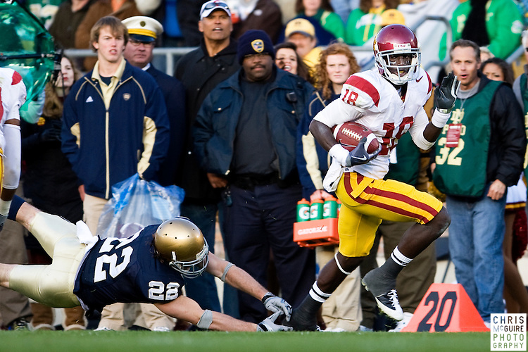 10/17/09 - South Bend, IN:  USC wide receiver Damian Williams evades tacklers on his way to a touchdown against Notre Dame during their game at Notre Dame Stadium on Saturday.  USC won the game 34-27 to extend its win streak over Notre Dame to 8 games.  Photo by Christopher McGuire.