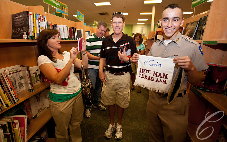 Texas A&amp;M Corps of Cadets freshman David Garcia  shows off his &quot;12th Man&quot; towel signed by presidential candidate Herman Cain. &quot;Fish&quot; Garcia is a member of the Fightin' Texas Aggie Band and from Bedford, Texas. <br />  Cain stopped in College Station, Texas to sign his book &quot;This is Herman Cain&quot; on October 6, 2011. College Station is the home of Texas A&amp;M University and the alma mater Cain's Republican rival Rick Perry.