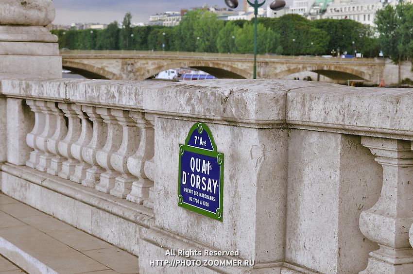 Quay d'Orsay, imbankment Orsay sign on the bridge
