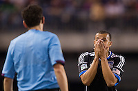 Jason Hernandez (21) of the San Jose Earthquakes reacts to a foul call during the second half against the New York Red Bulls. The New York Red Bulls and the San Jose Earthquakes played to a 2-2 tie during a Major League Soccer (MLS) match at Red Bull Arena in Harrison, NJ, on April 14, 2012.
