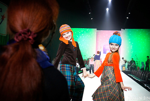 A pair of 10-year-old twins rehearse for the Fashion Week in Moscow. They are modelling for Moscow-based Teplitskaya Design...Photograph by Justin Jin