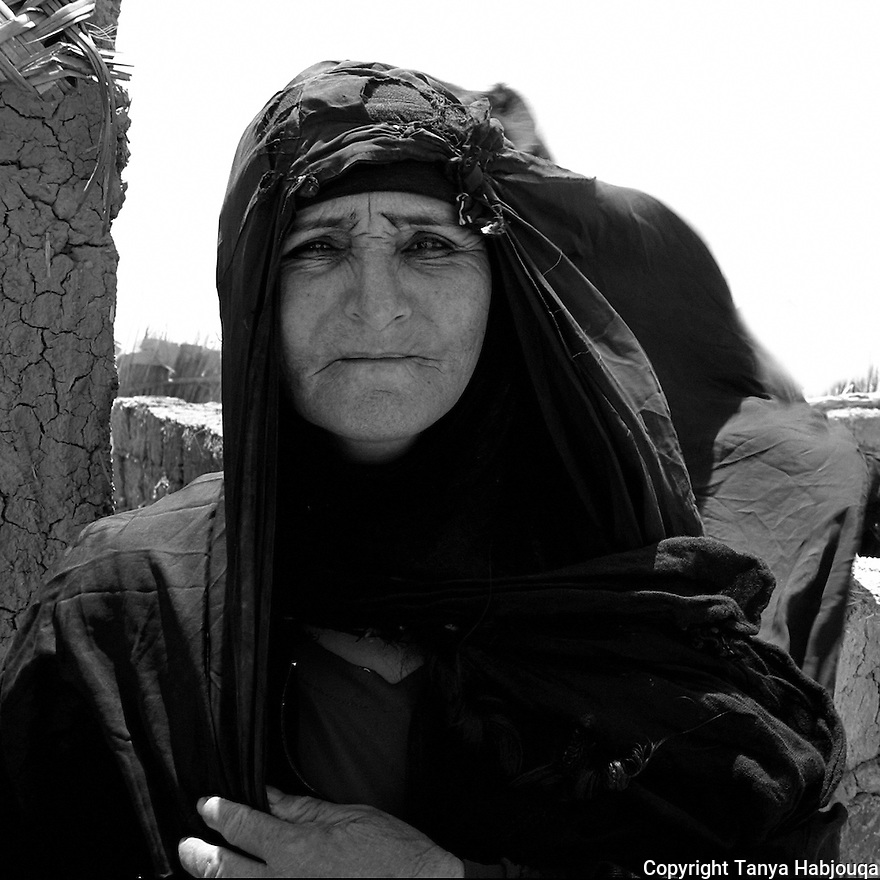 21st  July 2003.  Chibayish, Iraq... Medina, a mother of ten,  has returned to her marshland home after more than a decade, lured by the news that the marshes were miraculously coming back to life and that the land was no longer under Saddam's control. .. The displaced Marsh Arabs were forced off of their lands-- a connection that goes back centuries--when Saddam's regime drained the marshes, considered to be one of the greatest environmental crimes of the 21st century. <br />