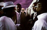 Black yuppies network at a black empowerment reception during the yearly Durban July horse race on July 3, 2004 in Durban in Natal Province, South Africa. Durban July is the biggest horse race in Africa and an important social event, where South Africa's celebrities dress up and watch the races. South Africa has seen a growing number of affluent blacks since the fall of Apartheid and start of democracy in 1994. (Photo by: Per-Anders Pettersson)  .....