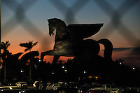 HALLANDALE BEACH, FL - JANUARY 28: The sun sets behind the Pegasus statue after the successful running of the inaugral Pegasus World Cup Invitational at Gulfstream Park. (Photo by Arron Haggart/Eclipse Sportswire/Getty Images