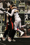 23 MAR 2012:  Katarzyna Dabrowa of Ohio State hugs her coach after beating Margherita Guzzi Vincenti of Penn State in the epee competition of the Division I Women's Fencing Championship held at St. John Arena on the Ohio State University campus in Columbus, OH. Dabrowa defeated Guzzi Vincenti 15-14 to claim the national title.  Jay LaPrete/ NCAA Photos