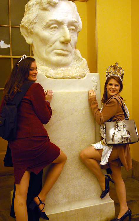 beautyqueen3/013002 - Kari Eve Hingle, 17 from Buras, La., and Leigh Ann Ally Kirkland, 18, from Addis, La., pose with a bust of Lincoln in the Capitol. They was part of a group Mardi Gras Queens and Princesses visiting Washington.