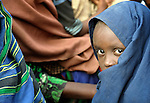 Nine-year old Habiba Husseim Hassan, a Somali girl whose family fled drought and war at home to trek for a month across east Africa, waits with her family to be registered in the Dadaab refugee camp in northeastern Kenya. Tens of thousands of newly arrived Somalis have swelled the population of what was already the world's largest refugee camp.