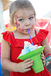 Avery Plaser of Los Altos enjoys a shaved ice at the 34th Annual Los Altos Arts & Wine Festival July 13.