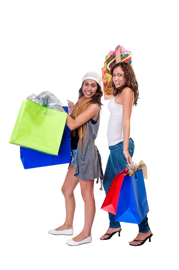 Young caucasian and hispanic girls with shopping bags very hsppy.